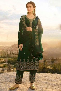 This Dark Green Satin Georgette Trouser Suit which will surely grabs everyone attention. Teamed up with Satin Georgette Trouser in Dark Green Color with matching Georgette Dupatta. Trouser has Resham, Zari and Stone work. Dupatta perfectly formed using Resham, Zari and Stone Work.