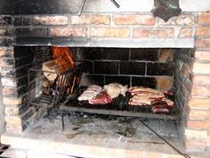 Uruguayan grill. Very efficient cooking system and a doable DIY project for the homestead.