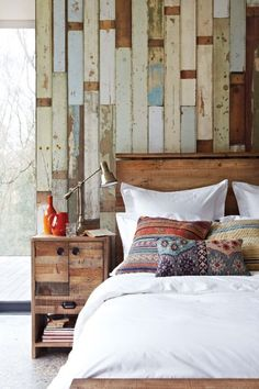 reclaimed wood wall behind bed