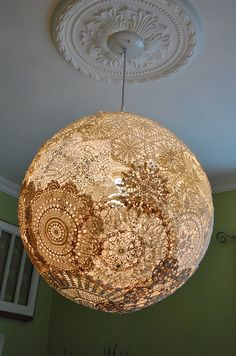 Shabby chic 18 doily pendant light fixture. Globe by HobbyFelt made with a light globe and doilies. Not sure how they put the doilies on the globe but this is gorgeous! I love it! Etsy
