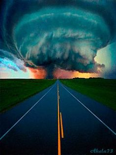 Tornado lowering toward touch down over a desolate highway. Just looking at this makes me fear and desire to be there in that moment. How awe inspiring!