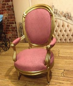 Pink chair, gold wood trim