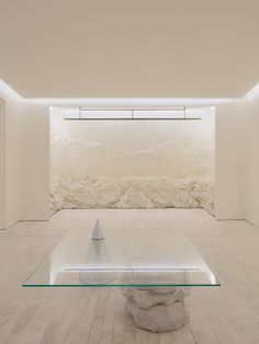 In an overly sleek high-tech world, a few tough edges can refresh the soul. Welcome to the new Stone Age where cave-like interiors and objects reign supreme Ceramic Wall Lights, Indirect Lighting, Level Homes, Retail Interior, Elements Of Design, Retail Space, Abstract Shapes, Retail Design, Interiores Design