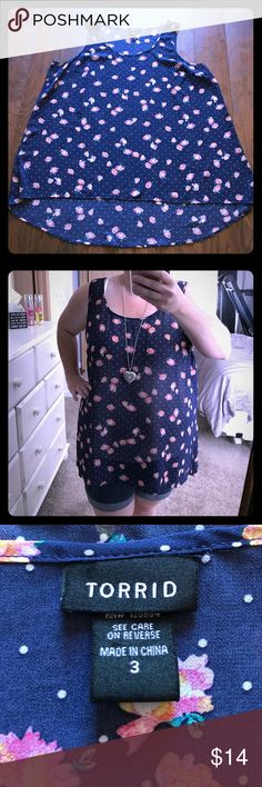 Torrid high low tank size 3 Cute floral tank! This sheer tank is a high-low style (longer in the back). Worn a few times but in great condition! I love the navy and floral pattern. ❤️ Size 3 torrid Tops Tank Tops