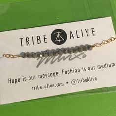 Tribe Alive Glass Bead Bracelet Grey Jade Gray hand-cut glass crystals on gold chain bracelet. Tribe Alive helps break the cycle of poverty by providing a platform to sell their wares. Bracelet is approximately 6.5 inches long and can be made shorter by hooking to chain. Tribe Alive Jewelry Bracelets