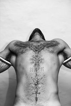 elven star, ankh, sacred geometry stomach and chest tattoos