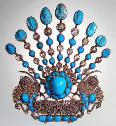 Spectacular Egret, created in the last quarter of the XIX-th century, on each of the spokes are turquoise stone carved portraits of Nasreddin Shah Qajar.