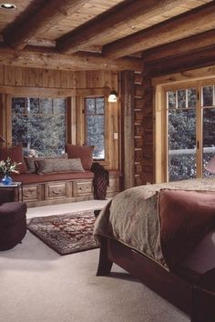 Rustic Guest Bedroom with Exposed beam, Window seat, Carpet, Wall sconce, Taos Log Column / Beam, Bay window