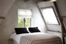 How cozy is this bedroom in the Bed and Breakfast In De Aap, Bergen Netherlands by North Sea. Owned by husband and wife duo Emile van de Bergh and Ymke van Zwoll.