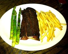Dry rub ribs with asparagus and fries from the Double J Smokehouse and Saloon in Memphis, TN.