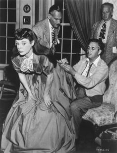 Last minute touches on Junes dress on the set of Little Women (1949)