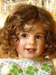 What a beautiful doll - looks like someone I know & love.. too cute