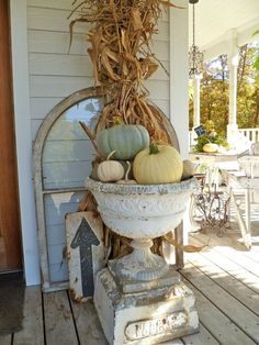 I just want the URN... DANG IT!  Large white urn with pumpkins and a corn stalk