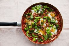 Tomato and broad bean stew with eggs, flatbread and yoghurt