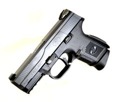 """FNH USA FNS-40 Compact .40 S&W. 66721. The FNS-40c from FNH USA is a compact version of their FNS40 pistol. Like its full-sized companion it offers DAO striker-fired operation. It features a stainless steel slide & barrel; ambi slide stop lever & mag release; checkered polymer frame; two interchangeable backstraps w/ lanyard eyelets; a MIL-STD 1913 accessory mounting rail; fixed 3-Dot Standard Sights. No manual safety. 14-round capacity of .40 S&W. 3.6"""" barrel. 25.8 oz. [New in Box] $499.99"""