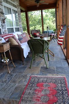 Lovin this country porch decorated in Americana. Great idea when we move....I've got tons of Americana.