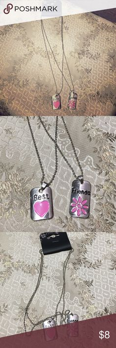 Best Friends 2 PC Necklace Set W/Pink Flower NEW This is a brand-new item for sale. BEST FRIENDS 2 PC NECKLACE SET. One for you and one for me :) Super cute and a fun way to show your bestie how much she is loved !! 💟 silver tone in color. Thank you for looking 🌺 unknown Jewelry Necklaces