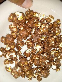 Stop buying the bags of flavored popcorn, they are full of chemicals and very unhealthy. I now make my own chocolate covered popcorn. This way I get to add as much or as little of the ingredients that I want. I use the dark chocolate wafers as dark chocolate is much healthier for you and I air pop my corn and use sea salt and coconut oil instead of lard and table salt [which is very unhealthy] Enjoy! :)