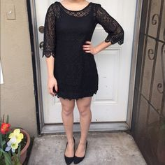 Black lace dress /XS/ excellent condition/sheer lace dress with slip attached/scoop neck(back is lower) see through sleeves with 3/4 sleeve-the sleeves also flare out/laying flat measurements-26.5 inches top to bottom (front) top to bottom (back) 24 inches model-5 feet for reference H&M Dresses Mini