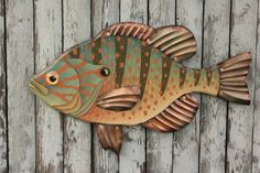 Small but scrappy, Pumpkinseed Sunfish are a kid favorite. These vibrant fish can often be caught from the dock or rocky shore using worms and a hook (and sometimes just a hook!). The Sunfish art in R