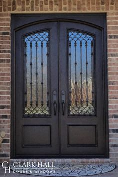 The ornate style of these custom wrought iron front entry doors transforms the entire design of the home's entrance. With large glass windows to let in the natural light, these custom made double doors take exterior double door ideas to the next level. Door Design Interior, Custom Exterior Doors, Iron Doors, Entrance Doors, Door Crafts, Ornate, Iron Entry Doors