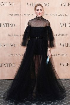 Iconic Olivia in Valentino: Olivia Palermo in glamorous ruffles Maison Valentino black tulle gown.