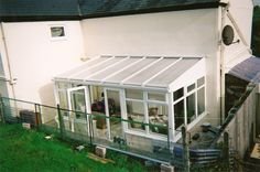 White PVCu DIY Lean-to Conservatory. Sunlounge Conservatories Manufactured and supplied by ConservatoryLand DIY Conservatories UK. Conservatory pictures kindly supplied by our customers.