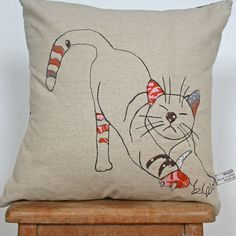 What I Always Wanted | Appliqued cushion in 100% linen - stretching cat design      inspiration only.  This is on a shop site.