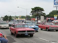Woodward Dream Cruise.  One million visitors and 40,000 cars ranging from classics to muscle to collectors converge on 16 miles of Woodward Avenue.