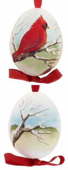 <p>For the bird-lover in your family, this blown chicken egg ornament is something they can display with pride. Hand-painted by a talented artisan in Austria, this Christmas egg ornament is detailed to feature a profile of a male cardinal facing right with his brilliant red feathers standing out against the snowy winter landscape. With bare tree branches trimmed in white glitter, this elegant egg ornament will shimmer as part of any collection. Display this Christmas egg on your tree or ...