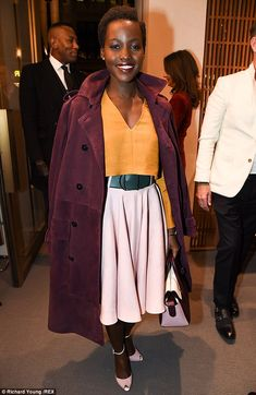 Pretty in pink: Lupita's pink outfit looked stunning with her orange tip as she posed for pictures