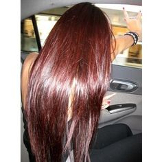 Chocolate brown with dark red highlights. Coca cola hair