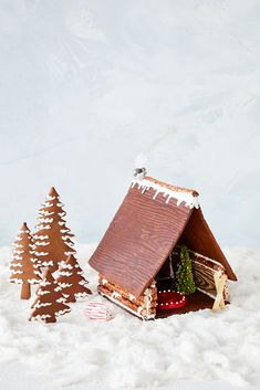 "Santa's got a brand-new. This well-appointed A-frame flips the script on traditional gingerbread houses, with a rustic-chic exterior and a cozy interior complete with a ""stone"" fireplace. Christmas Games, Christmas Cookies, Christmas Baking, Cozy Christmas, Christmas Activities, Christmas Treats, Italian Christmas, Holiday Baking, Christmas Recipes"