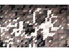 Wool rug with optical pattern SKULL by NOW CARPETS | design Claudio Colucci