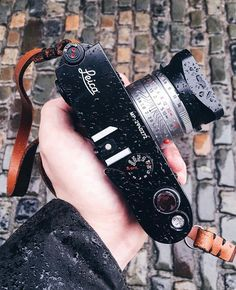 It's always neat to see someone test the mechanical limits of their gear. @jackbroady had to contend with some rain recently but his Leica MP didn't miss a beat. Sure the sight of a wet Leica may horrify some people but for others it's all part of the photographic experience and there's a difference between taking care of your gear and being overly protective of it. I won't lie though I'd be wary of getting it too wet! #cameracult #leica #leicamp #rangefinder #filmcamera #35mmfilm…