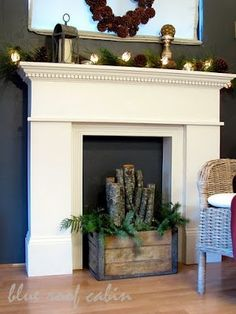 DIY Faux fireplace.  Love the box with sticks!!!