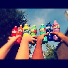 Fill the bottles with paint. Take a pin and poke a hole in the caps of the bottles. Get all your friends together, and have a paint fight (like a water fight)!!!!
