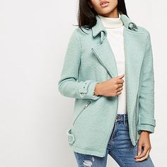 Bouclé cloth fabric Oversized fit  Tonal wool collar Asymmetric zip front Long cuffed sleeves Zip side pockets and buckled hem