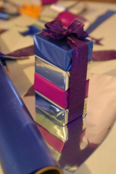 .Use inexpensive foil or mylar paper to wrap and stack small gifts. #giftwrap