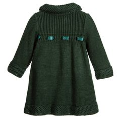 Baby dark green knitted coat and bonnet set by Foque. This traditionally styled outfit is ideal to be worn as a pram coat on colder days. It has a soft feel and a patterned collar and trim, with popper fastening. The matching bonnet has ribbon ties that secure in a bow under the chin.