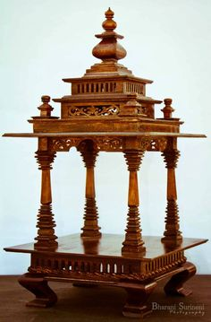 Puja Product Code : This design made in wood reminds of various architechtural marvels of India in its pillars. This item is available [. Wooden Temple For Home, Temple Design For Home, Home Temple, Temple Architecture, Indian Architecture, Altar, Mandir Design, Wooden Main Door Design, Pooja Room Door Design