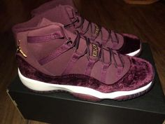"""Jordan continues the """"Heiress"""" collection for the holiday season with the release of the Air Jordan 11 Retro GG """"Heiress."""" The sneaker features a  Set to release during the holiday season, the sneaker will features a night maroon and gold velvet-based upper. Release date is Dec. 17, 2016 at a retail price of $220."""