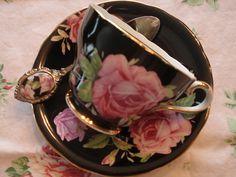 Stunning teacup...black with pink roses by eg2006, via Flickr