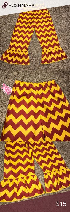 NWT Ruffle Pants NWT! Never worn red and gold chevron ruffle pants with elastic waistband. Perfect pants to complete your USC, KC Chiefs or 49er outfit?! Comes from a smoke free home. Lolly Wolly Doodle Bottoms