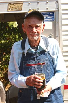 C.B. Reese, born in 1922, pictured with a jar of sorghum molasses. It is amazing--almost unbelievable--how the world has changed since he was born. The hubby and I had the opportunity to hear about those changes first hand from Mr. C.B. Honestly, I could sit a spell with Mr. C.B. all day for a week!!