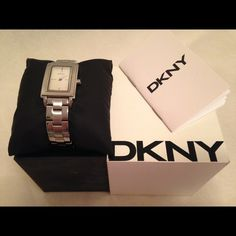 Authentic DKNY watch Well loved/used Solid stainless steel watch. Really classic nothing too fancy or following trends this watch will always go with any kind of outfit very classic. I pair these with simple shirt whenever I go to work and I got many compliments on them. Very well loved and condition is as shown in the picture but it needs battery changed. Model : NY-8280 DKNY Accessories Watches