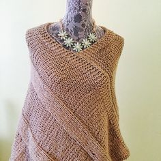 This is a soft , organic cotton , hand knitted poncho. Perfect for brisk summer nights or over your favorite winter outfit . Can be dressed up