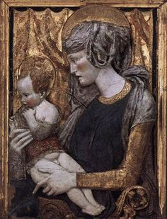 Donatello | Madonna and Child, ca 1440, polychrome terracotta,   Musée du Louvre | This relief is attributed to Donatello or his immediate circle, with a disputed dating. The Madonna and Child are both looking in the same direction with concentration, even effort. The absence of the visual contact between the mother and child does not, however, in any way affect the intimacy of the scene, which is communicated in the gentle way Mary is embracing her child.