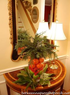 Easy Christmas Centerpiece You Can Make in 15 Minutes Using Greenery from Your Yard by Between Naps on the Porch.
