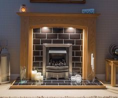 """Gary Waterhouse's Lyndhurst Oak Surroud, looking awesome with the addition of downlights. """" All other retailers should take note, this company knows how to do business. Oak Fire Surround, Electric Fireplace, Fireplace Surrounds, Downlights, Solid Oak, Note, Living Room, Business, Awesome"""